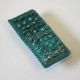 Turquoise brooch by textile artist Mary Taylor